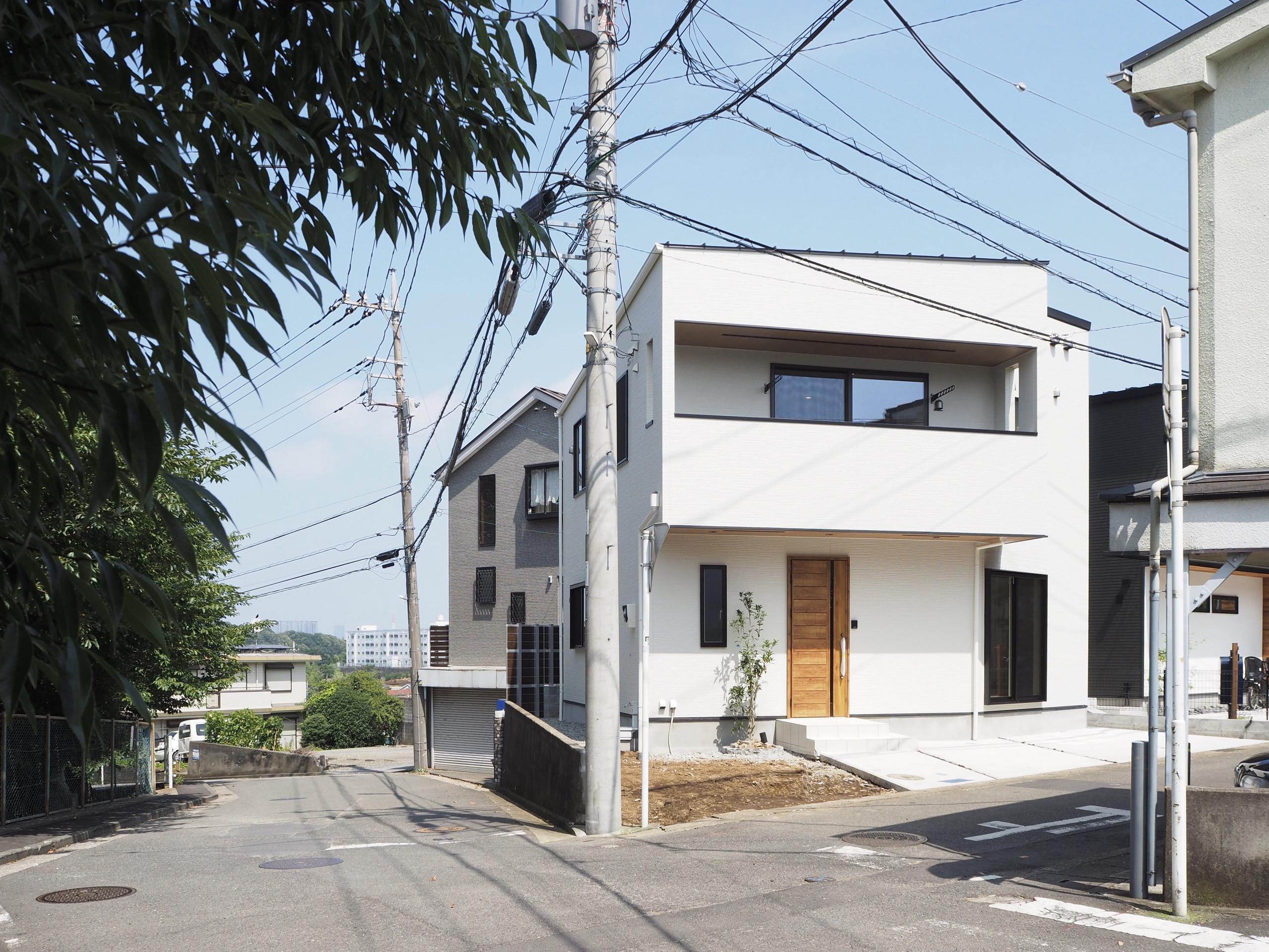 桜並木沿いの家の建築事例写真